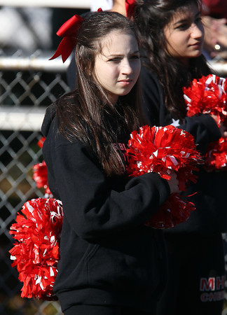 Marblehead freshman cheerleader Whitney Rosenberg holds her hand over her heart during the playing of the National Anthem prior to the start of the Beverly Marblehead football game on Saturday afternoon. David Le/Staff Photo