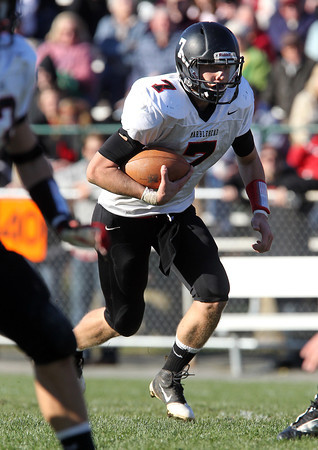 Marblehead senior quarterback Ian Maag looks for a hole to open up on a quarterback keeper against Beverly on Saturday afternoon. David Le/Staff Photo