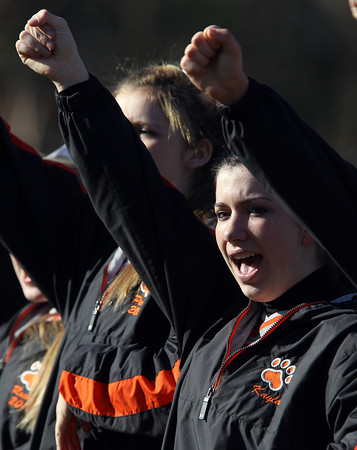 Beverly junior Kayla Beaulieu cheers on the Panthers as they run onto the field at the start of the Beverly-Marblehead on Saturday afternoon. David Le/Staff Photo