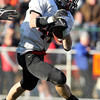 Marblehead running back Brooks Tyrrell cuts back against Beverly on Saturday afternoon. David Le/Staff Photo