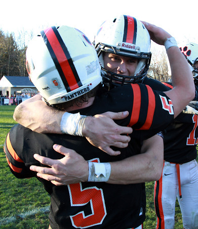 Beverly senior running backs Dom Abate, left, and Kenny Pierce, right, hug after the Panthers defeated the Magicians 35-14 to clinch the NEC/CAL Tier 2 Championship on Saturday afternoon at Hurd Stadium. David Le/Staff Photo