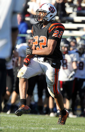 Beverly junior Isiah White celebrates after tackling Marblehead running back Brooks Tyrrell in the backfield for a loss of yards on Saturday afternoon. White and the Panthers defeated the Magicians 35-14 to capture the NEC/CAL Tier 2 Championship. David Le/Staff Photo