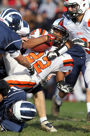 Beverly junior running back Isiah White gets upended by a few Swampscott defenders on Saturday afternoon. David Le/Staff Photo