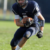 Swampscott senior captain Aaron Cronin turns upfield against Beverly on Saturday afternoon. David Le/Staff Photo