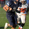 Swampscott wide receiver Josh Rothwell breaks away from Beverly defenders on Saturday afternoon. David Le/Staff Photo
