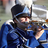 Swampscott High School junior Sophie Forman, plays the trombone during the Swampscott High School Marching Band's Halftime show of the football game on Saturday afternoon. David Le/Staff Photo