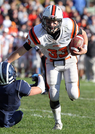 Beverly senior captain Brendan Flaherty stiffarms a Swampscott defender down en route to a long run. Flaherty and the Panthers took care of business on Saturday afternoon, defeating the Big Blue 40-6 at Blocksidge Field. David Le/Staff Photo