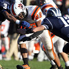 Beverly junior running back Isiah White puts his head down and plows through a few Swampscott defenders on Saturday afternoon. David Le/Staff Photo