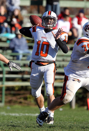 Beverly senior quarterback Dave Rollins drops back to pass against Swampscott on Saturday afternoon. David Le/Staff Photo