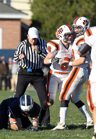 Beverly senior Luke McDonald, center, gets congratulated by teammate Brendan Flaherty, right, after McDonald took down Swampscott senior Corey Carmody, left, on a reverse to stop the Big Blue on Saturday afternoon. David Le/Staff Photo