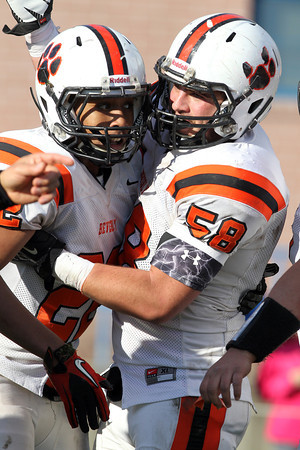 Beverly junior running back Isiah White, left, gets congratulated by senior offensive lineman Brian Perry, right, after White scored a touchdown against Swampscott on Saturday afternoon. White and the Panthers scored early and often, defeating the Big Blue 40-6 at Blocksidge Field. David Le/Staff Photo