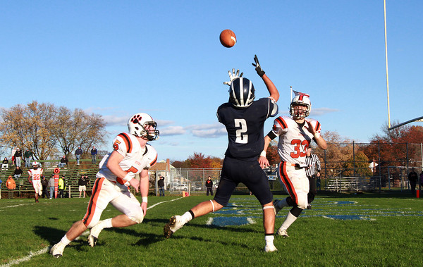 Swampscott senior wide receiver Josh Rothwell, center, looks in the football but can't hang on while being pursued by Beverly seniors Dom Abate, left, and Brendan Flaherty, right, on Saturday afternoon. David Le/Staff Photo