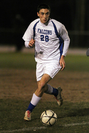 Danvers senior Drew Piazza carries the ball upfield against Concord-Carlisle on Tuesday evening. David Le/Staff Photo