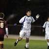 Danvers junior defender Matt Kidney wins a header in midfield on Tuesday evening against Concord-Carlisle. David Le/Staff Photo