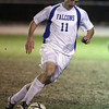 Danvers senior midfielder Eric Martin carries the ball upfield on Tuesday evening. David Le/Staff Photo