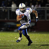 Danvers High School running back Alex Valles rips off a long touchdown run against Marblehead on Friday evening. David Le/Staff Photo