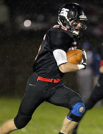Marblehead senior running back Zac Cuzner breaks free for a long run against Danvers on Friday evening. David Le/Staff Photo