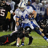 Danvers High School running back Alex Grant, center, gets taken down by Marblehead's Sam Stern, left, and Trey Blackmer, right, on Friday evening. David Le/Staff Photo