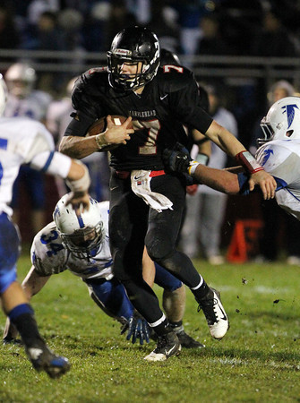 Marblehead quarterback Ian Maag scrambles out of the pocket against Danvers on Friday evening. David Le/Staff Photo