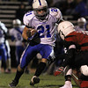 Danvers junior running back Alex Valles makes a cutback against Salem on Friday evening. David Le/Staff Photo