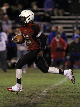 Salem High School quarterback Christian Dunston breaks free of the Danvers defense and rushes for a 69 yard TD on Friday evening. David Le/Staff Photo