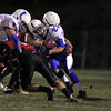 Danvers running back John Thomas, right, gets stuffed on a run by multiple Salem defenders. David Le/Staff Photo