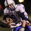Danvers High School quarterback Nick Andreas powers forward for a few extra yards against Salem on Friday evening. David Le/Staff Photo