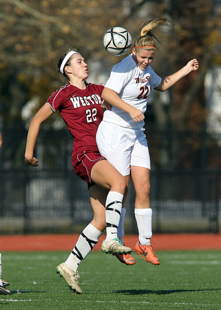 Ipswich senior Brigid O'Flynn, right, and Weston sophomore Tally Shea, left, collide as they compete for a header in midfield during the D3 North Final on Monday morning. David Le/Staff Photo
