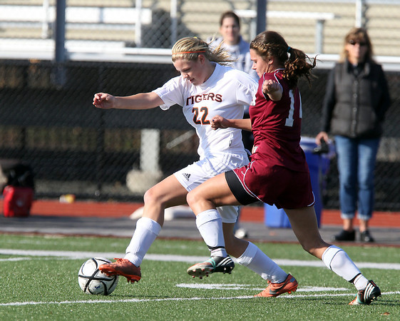 Ipswich senior Brigid O'Flynn, left, controls the ball while being pursued by Weston senior Hannah Graves, right, on Monday morning in the D3 North Final. David Le/Staff Photo