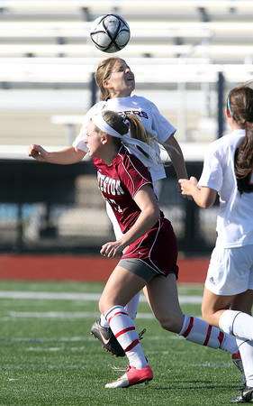 Ipswich junior defense Claire Gardner wins a header over Weston sophomore Lane Cronin during the first half of the D3 North Final match on Monday morning at Manning Field in Lynn. David Le/Staff Photo