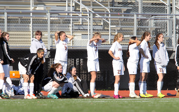 Members of the Ipswich Girls Soccer team react after Weston scored their 2nd goal of the game to go up 2-0 over the Tigers. Ipswich fell to Weston 2-0 in the D3 North Final match at Manning Field in Lynn on Monday morning. David Le/Staff Photo