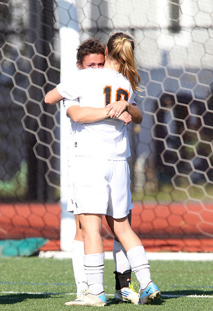 Ipswich senior captain Courtney Long, left, gets a hug from junior teammate Katie Monahan, right, following the Tigers' 2-0 loss to Weston in the D3 North Final match at Manning Field in Lynn on Monday morning. David Le/Staff Photo