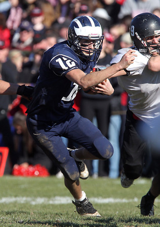 Swampscott quarterback Brian Santy surges forward for a short gain against Marblehead on Thanksgiving Day. David Le/Staff Photo