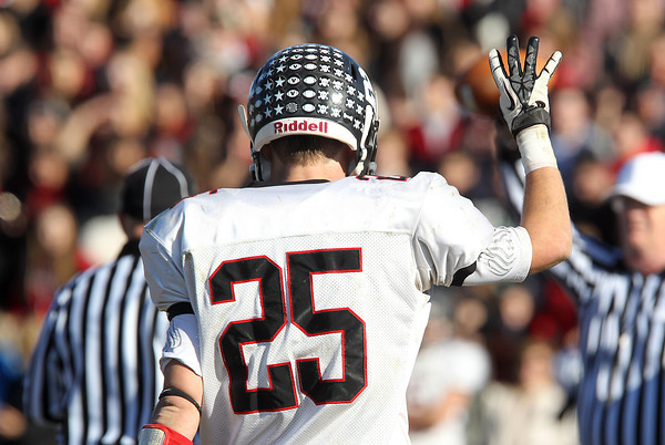 Marblehead senior Zac Cuzner holds 4 fingers in the air at the start of the 4th quarter of play against Swampscott on Thanksgiving Day. David Le/Staff Photo