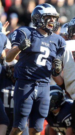 Swampscott senior captain Josh Rothwell pumps his fists and screams in celebration after the Big Blue scored another touchdown to pull away from the Magicians 25-16 on Thanksgiving morning. David Le/Staff Photo