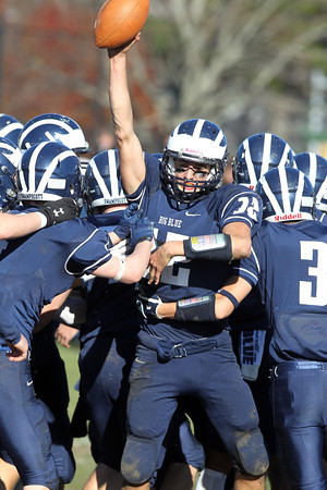 Swampscott senior quarterback Brian Santry, center, gets mobbed by teammates following a 25-16 Thanksgiving win over Marblehead. David Le/Staff Photo