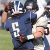 Marblehead senior captain Kyle McCormack, right, and Swampscott senior captain Robert Serino, left, embrace at midfield following a 25-16 Big Blue victory on Thursday afternoon. David Le/Staff Photo