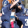 Swampscott senior quarterback Brian Santry, right, and junior Ben Faulkner, left, jump up in celebration after defeating Marblehead 25-16 on Thursday morning. David Le/Staff Photo