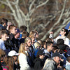 Swampscott senior TJ Ledbury, right, pumps up the Swampscott High cheering section on Thursday morning as the Big Blue took on the Marblehead Magicians in the annual Thanksgiving Day game. David Le/Staff Photo