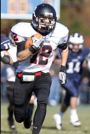 Marblehead junior Brian Daly escapes the Swampscott defense for a long kickoff return on Thanksgiving. David Le/Staff Photo
