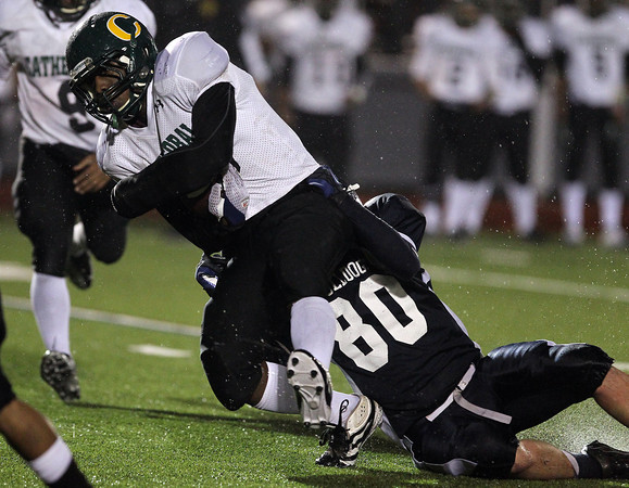 North Shore Tech senior Bryan Jackson, right, drags down Cathedral running back Sage Philippe, on Tuesday evening in the second quarter of the Eastern Mass D4A semi-final at Varsity Field in Burlington. David Le/Staff Photo