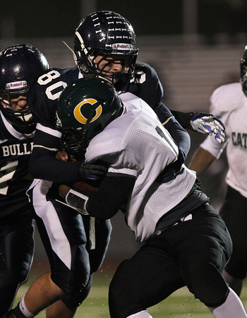 North Shore Tech senior Bryan Jackson, left, stands up Cathedral running back Jermal Brevard-Jackson, at the line of scrimmage for no gain on Tuesday evening. The Bulldogs battled the Panthers in the Eastern Mass D4A semi-final but couldn't pull out a victory, falling 30-14 at Varsity Field in Burlington. David Le/Staff Photo