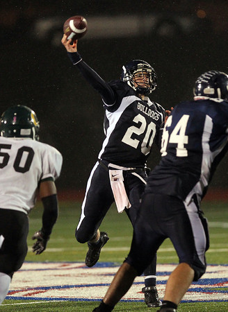 North Shore Tech senior quarterback Tim Andersen launches a pass downfield against Cathedral in the Eastern Mass D4A semi-final at Varsity Field in Burlington on Tuesday evening. David Le/Staff Photo