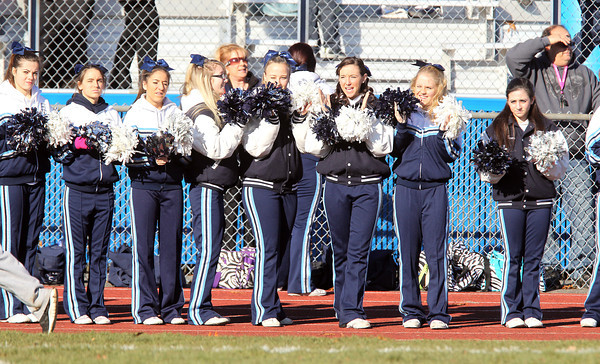 The Peabody High School cheerleaders welcome the Tanners as they take the field on Thanksgiving morning for their game against Saugus. David Le/Staff Photo