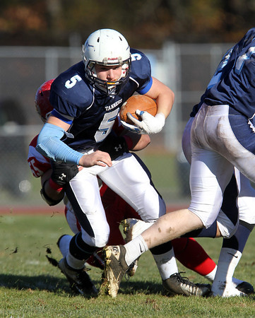 Peabody junior Cody Wlasuk powers forward for a few additional yards against Saugus on Thanksgiving morning. David Le/Staff Photo