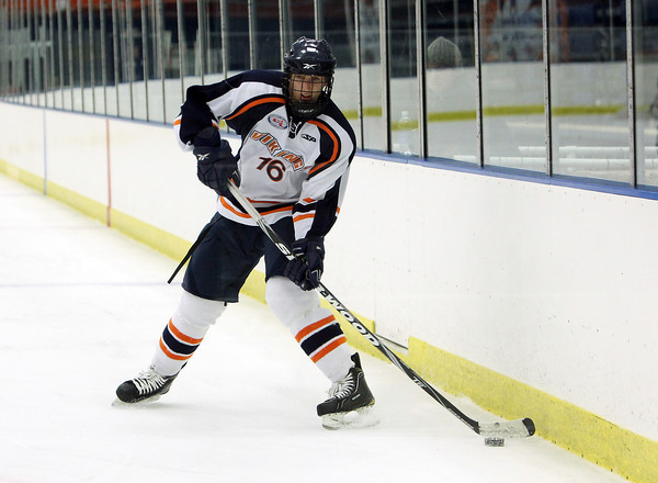 Salem State University freshman defense Brad Jones controls the puck along the boards against Wentworth in the Vikings home opener on Wednesday night at Rockett Arena. David Le/Staff Photo