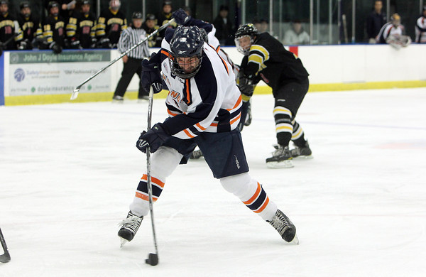 Salem State freshman forward Cam Moniz rips a shot on net against Wentworth on Wednesday night. David Le/Staff Photo