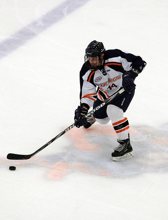 Salem State freshman forward Chris Mastropietro passes the puck to a teammate against Wentworth in the Vikings home opener on Wednesday evening. David Le/Staff Photo