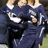 St. John's Prep senior Tommy Buonopane, left, hugs teammate Bruce Ocko, right, following a 2-1 Eagles win over Masco at Manning Field in Lynn. Ocko scored the game winning goal with 4:06 to play sending the Eagles to the D1 North Final against Sommerville on Sunday afternoon. David Le/Staff Photo