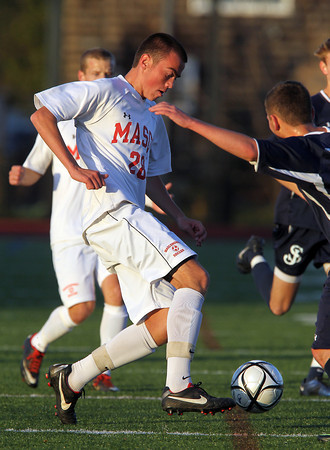 Masco sophomore back Kevin Gilbert controls the ball against St. John's Prep in the D1 North Semi-Final at Manning Field in Lynn. David Le/Staff Photo